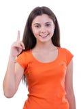 Donna casuale che indica per aprirsi Immagini Stock Libere da Diritti