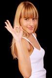 Donna casuale che sorride con i suoi pollici in su Fotografie Stock Libere da Diritti