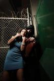 Donna che è attaccata Fotografia Stock