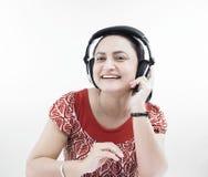 Donna che ascolta la musica Fotografia Stock