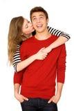Donna che bacia uomo Immagini Stock