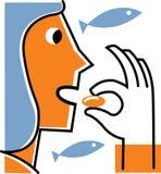 Donna che cattura supplemento dell'olio di pesce Fotografie Stock Libere da Diritti