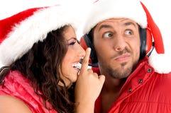 Donna che chiede all'uomo di mantenere silenzioso Fotografie Stock