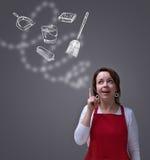 Donna che compone un piano di pulizie di primavera Fotografie Stock