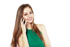 Donna che comunica sul mobile immagini stock