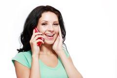 Donna che comunica sul mobile fotografia stock