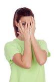 Donna che copre il suo fronte di mani Fotografia Stock Libera da Diritti