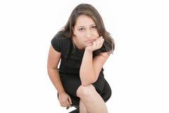 Donna che esamina diritto la macchina fotografica Fotografia Stock