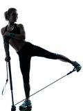 Donna che esercita allenamento di forma fisica del gymstick Immagini Stock