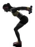 Donna che esercita la siluetta di addestramento del peso di allenamento di forma fisica Immagine Stock