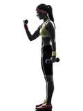 Donna che esercita la siluetta di addestramento del peso di allenamento di forma fisica Immagine Stock Libera da Diritti