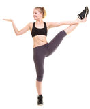 Donna che esercita salto allungando dancing Immagine Stock