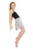 Donna che esercita salto allungando dancing Fotografia Stock Libera da Diritti