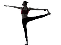 Donna che esercita yoga Hasta Padangusthasana Fotografia Stock