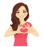 Donna che fa forma del cuore con le mani illustrazione di stock