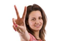 Donna che fa vittoria fotografie stock