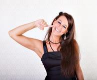Donna che gesturing gusto buon fotografia stock libera da diritti