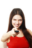 Donna che giudica TV telecomandata Immagini Stock