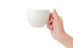Donna che giudica una tazza di caffè isolata su fondo bianco Fotografia Stock