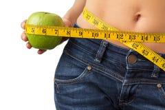 Donna che gode di riuscita perdita di peso immagini stock