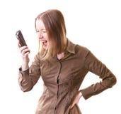 Donna che grida sul telefono Fotografia Stock