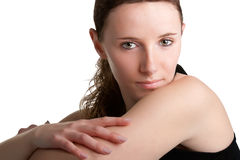 Donna che guarda sopra la sua spalla Immagini Stock