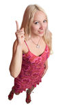 Donna che indica in su Fotografie Stock