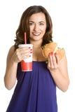 Donna che mangia alimenti a rapida preparazione Fotografia Stock Libera da Diritti