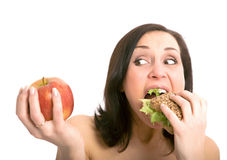 Donna che mangia hamburger Fotografia Stock Libera da Diritti