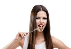 Donna che mangia la carne dell'arrosto Immagine Stock Libera da Diritti