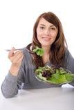 Donna che mangia un'insalata fotografia stock