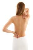 Donna che massaggia la parte posteriore di dolore Immagini Stock Libere da Diritti