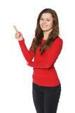 Donna che mostra indicare e sorridere Immagine Stock Libera da Diritti