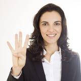 Donna che mostra numero quattro immagine stock