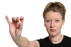 Donna che mostra pillola Fotografie Stock