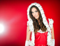 Donna che porta i vestiti del Babbo Natale Fotografia Stock