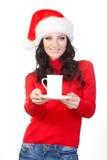 Donna che porta la tazza della holding del cappello della Santa sulla zolla Immagini Stock