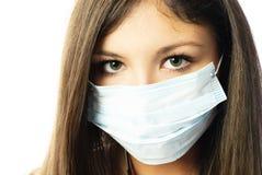 Donna che porta una mascherina protettiva Fotografia Stock