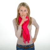 Donna che propone un gesto di silenzio fotografia stock