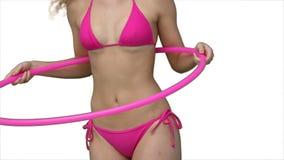 Donna che prova ad usare un hula-hoop Fotografia Stock