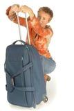Donna che prova alla valigia del colse Immagini Stock