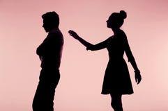 Donna che prova a scusarsi il suo ragazzo Immagine Stock Libera da Diritti
