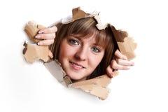 Donna che proveniente fuori dal tabellone per le affissioni Fotografia Stock