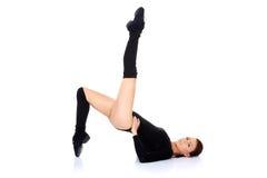 Donna che risolve facendo gli esercizi Fotografia Stock
