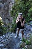 Donna che sembra sorpresa Fotografia Stock