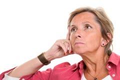 Donna che sembra triste Immagine Stock