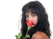 Donna che sente l'odore di una Rosa Fotografie Stock