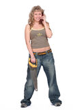 Donna che si leva in piedi con il telefono e fotografie stock