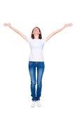 Donna che si leva in piedi con le mani in su sollevate Fotografie Stock