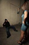 Donna che si leva in piedi sopra il ladro Fotografia Stock Libera da Diritti